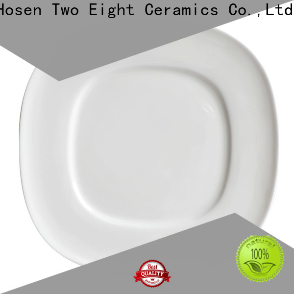 Two Eight white porcelain plates company for dinner