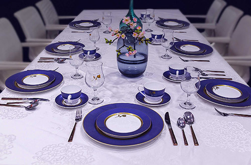 The Story of Gold Rose With Blue Rim on the Dinnerware Set
